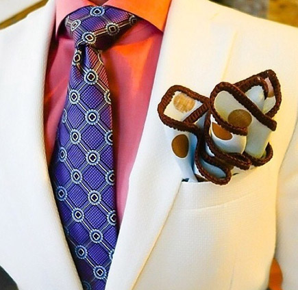 a purple tie and white jacket